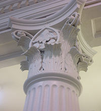 Photo showing ornamentatation on a column capital in the library.